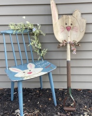 Blue chair painted with rabbit and a shovel made into a rabbit head