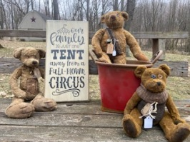 Three primitive bears and wooden stenciled sign