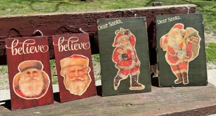 Paper Santas on red and green boards