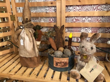 Primitive bunny with apron, metal bunny with eggs, carrot and light in paper box and a stuffed bunny with card
