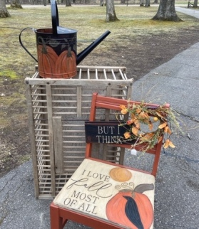Watering can with pumpkins painted on it and chair painted with I love fall most of all
