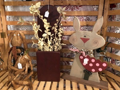 primitive rabbit, red wood box with white florals, and wooden bunny with red polka dotted flower