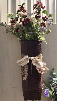 "24"" tall skinny basket with flowers and beige ribbon"