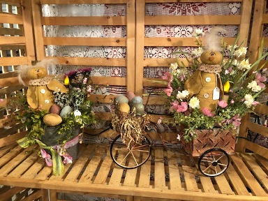 Primitive chicks in bucket and bicycle basket with eggs and florals